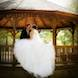 columbia missouri wedding photographer: a bride and groom kiss at gazebo