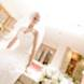 columbia missouri wedding photographer: bride soft focus by flowers